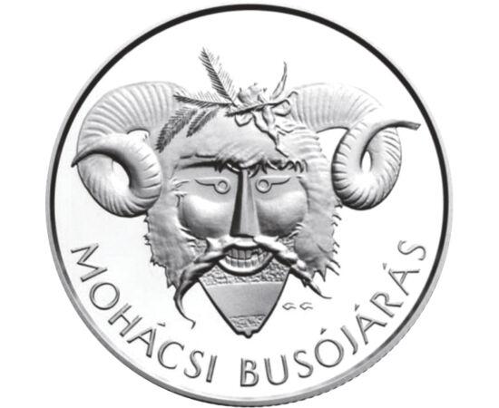 // 5000 forint, 925-ös ezüst, Magyar Köztársaság, 2011 // - Kilenc éve jelent meg ez a mohácsi emlékpénz a kulturális örökségeink kapcsán. Egy izgalmas és vidám farsangi hagyományt, a Mohácsi Busójárást jeleníti meg a 2011-es ezüst emlékpénz. A mohácsiak