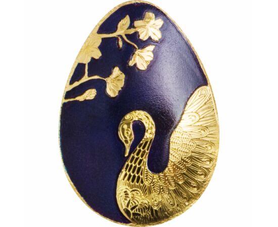 // 1 dollár, 999,9-es arany, Palau, 2019-2020 // - Csodálatos aranytojás alakú színarany érme, melyen a királykék festés méltó hátteret biztosít az arany hattyúnak és a virágágnak. Különösen figyelemre méltó a hattyú tollazatának finoman kidolgozott rajzo