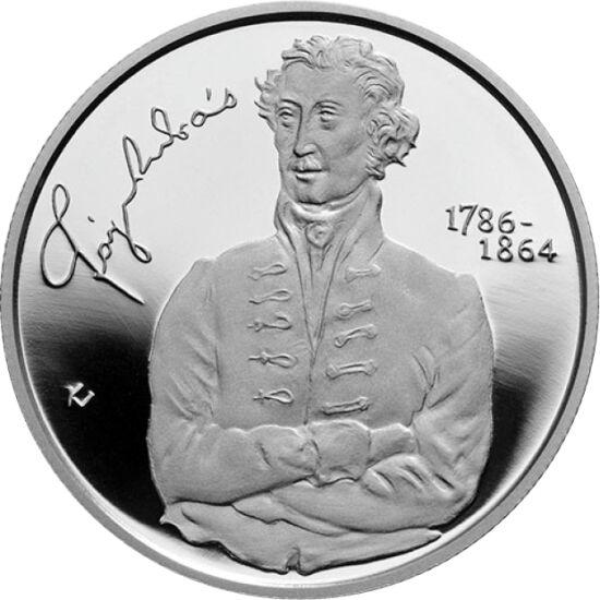 """// 5000 forint, 925-ös ezüst, Magyarország, 2014 // - 1864-ben hunyt el a """"nemzet mindenese"""", Fáy András. Nevéhez kötődik a Pesti Hazai Első Takarékpénztár megalapítása. A 2014-ben megjelent ezüst 5000 forinton a Takarékpénztárt jelképező, az épületét is"""